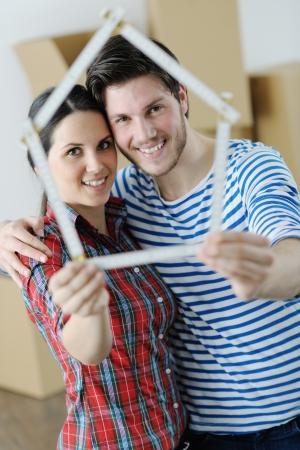 Foto de happy Young couple moving in new house - Imagen libre de derechos