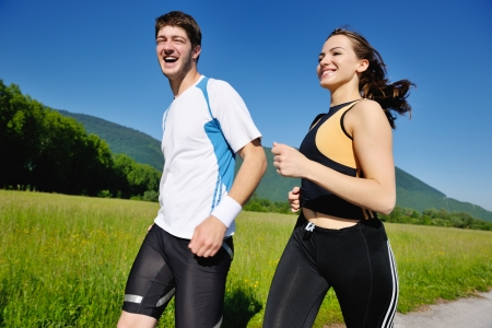 Photo pour Young couple jogging in park at morning. Health and fitness. - image libre de droit