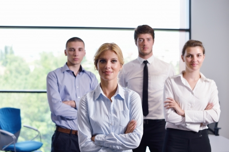 Photo for business woman  with her staff,  people group in background at modern bright office indoors - Royalty Free Image