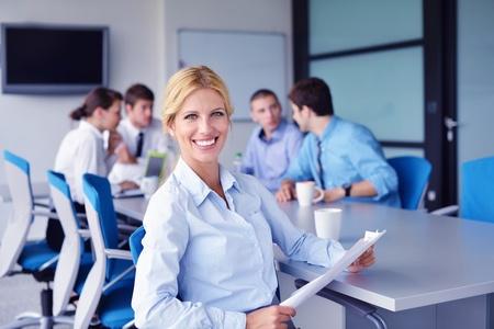 Foto de Group of happy young  business people in a meeting at office - Imagen libre de derechos