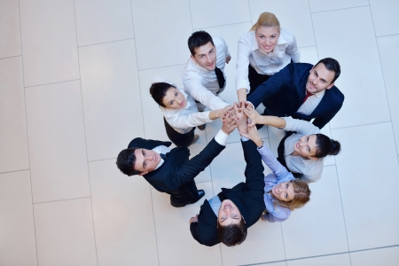 Photo for business people group joining hands and stay as team in circle  and representing concept of friendship and teamwork - Royalty Free Image