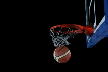 Basketball ball,  board and net  on black background in gym indoor