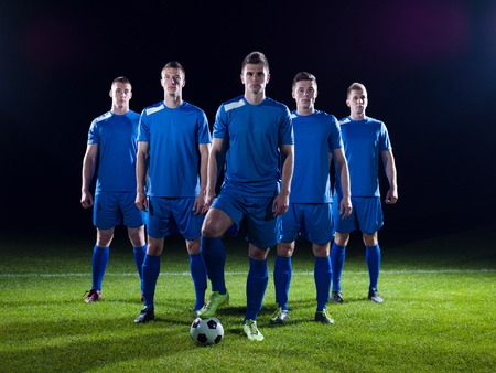 Photo for soccer players team group isolated on black background - Royalty Free Image