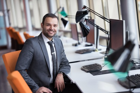 Foto de happy young business man portrait in bright modern office indoor - Imagen libre de derechos