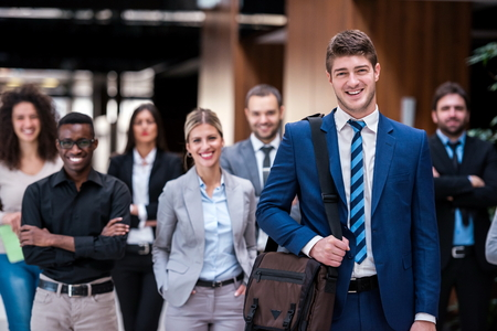 Photo for young multi ethnic business people group walking standing and top view - Royalty Free Image