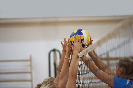 Photo for volleyball game sport with group of young beautiful girls indoor in sport arena school gym - Royalty Free Image