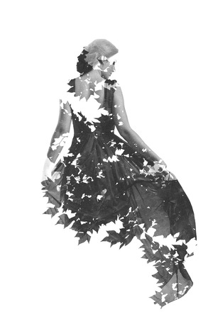 double exposure of woman in fashion dress with nature tree branches background