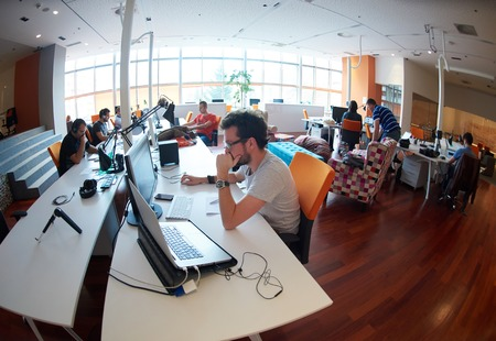 Foto de startup business people group working everyday job  at modern office - Imagen libre de derechos