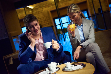 young business people couple relaxing after work in bar restaurant and take drink