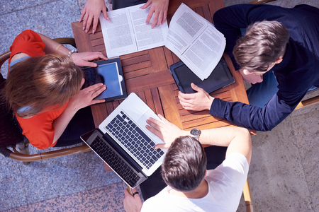 Photo for students group working on school  project  together at modern university, top view teamwork business concept - Royalty Free Image