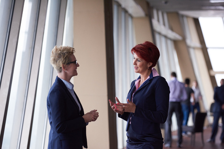 Photo for portrait  of two corporate business woman at modern bright office interior standing in group as team - Royalty Free Image