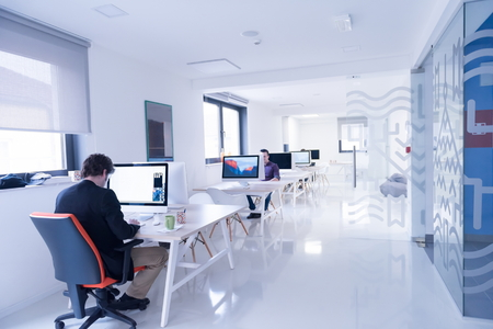 Foto de startup business, software developer working on computer at modern office - Imagen libre de derechos