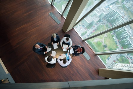 Photo for top view of happy  business people group on meeting throwing documents in air at modern office interior - Royalty Free Image