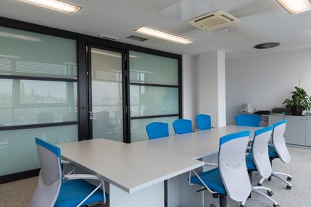Foto de interior of new modern office meeting room with big windows - Imagen libre de derechos