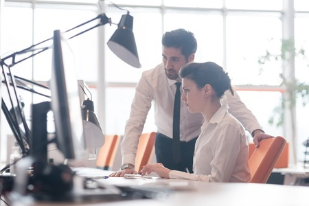 Foto per business couple working together on project at modern startup office - Immagine Royalty Free