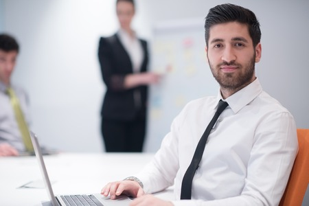 Photo pour portrait of young modern arab business man with beard at office meeting room,   group of  business people  on brainstorming and  making plans and projects on white flip board in  background - image libre de droit