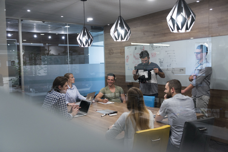 Foto de startup business team brainstorming on meeting   working on laptop and tablet computer - Imagen libre de derechos