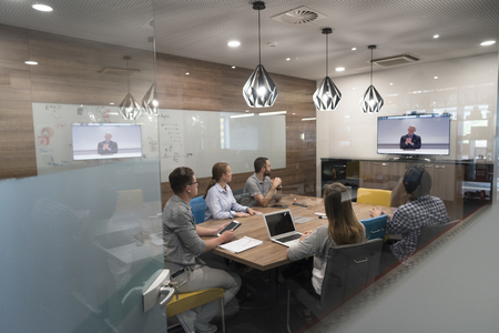 Photo pour start up business people group attending videoconference call with senior investitior at modern office - image libre de droit