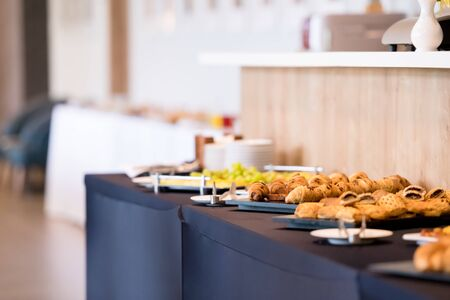 Foto de catering on a business conference  Coffee break table on business seminar with fresh bakery,beverage and fruit - Imagen libre de derechos