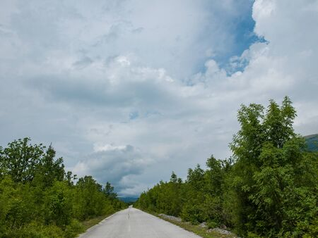 Photo for emptry road on countryside at cloudy  summer day - Royalty Free Image