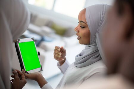Photo pour group of happy african students having conversation and team meeting working together on homework girls wearing traidiional sudan muslim hijab fashion - image libre de droit