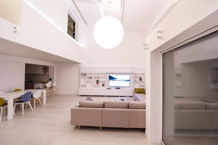 Foto de interior of a luxury stylish modern open space design two level apartment with white walls - Imagen libre de derechos