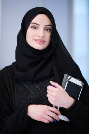 Photo pour young modern muslim business woman holding tablet computer wearing hijab clothes at home - image libre de droit