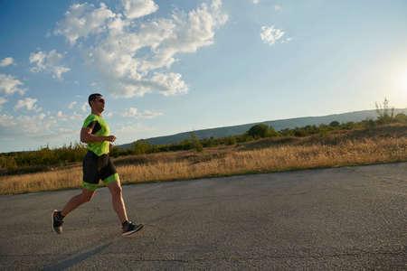 Foto de triathlon athlete running on morning trainig - Imagen libre de derechos