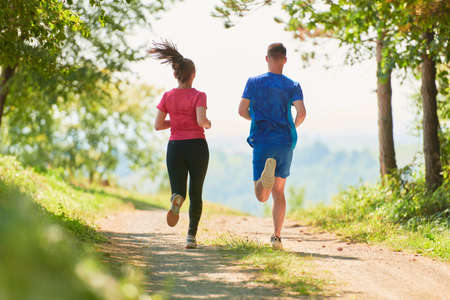 Foto für couple enjoying in a healthy lifestyle while jogging on a country road - Lizenzfreies Bild