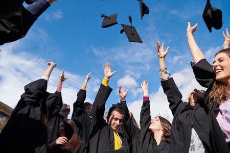 Photo pour Group of diverse international graduating students celebrating - image libre de droit