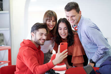 Photo pour Group of multiethnic teenagers taking a selfie in schoolthe student uses a notebook and a school library - image libre de droit