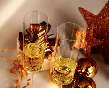 Glasses of champagne with christmas ornaments