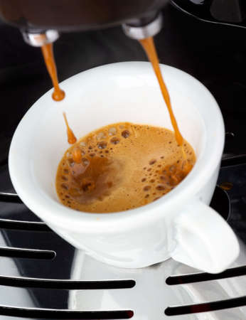 Fresh steaming espresso coffee being made