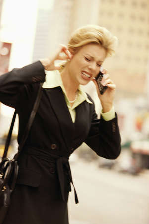 female executive on cell phone on downtown street