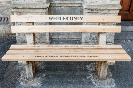 CAPE TOWN, SOUTH AFRICA - DECEMBER 18TH, 2014: Reconstructed apartheid bench in front of the High Court building explaining the race re-classification act of 1938