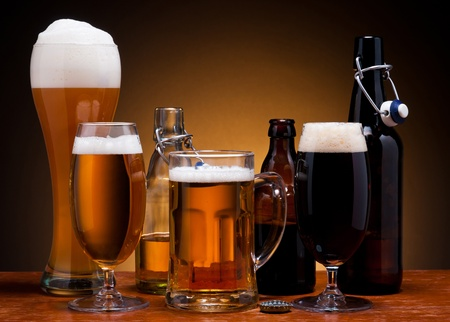 still life with different types of beer in glass and bottle
