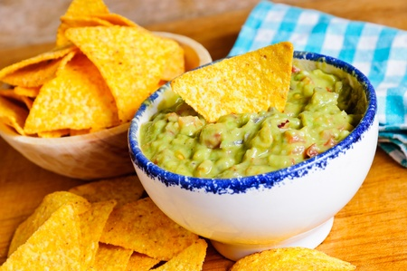 Tortilla chips with guacamole dip