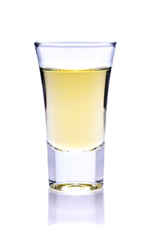 shot of tequila or whiskey isolated on a white background