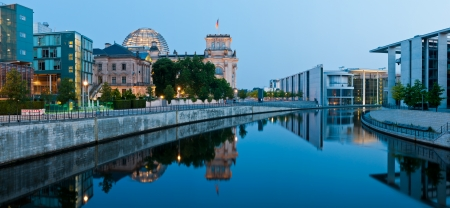 panorama with reichstagufer and spree river in berlin, germany at night