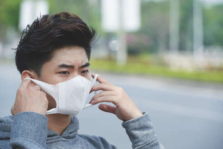 Face of Asian young man wearing face mask