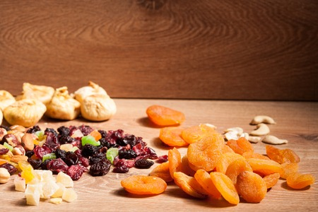 Mix of different dried fruits on wooden background : Royalty
