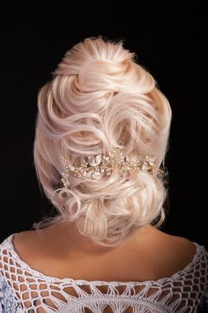 Foto de Back view of advanced coiffure on beautiful blonde woman. - Imagen libre de derechos