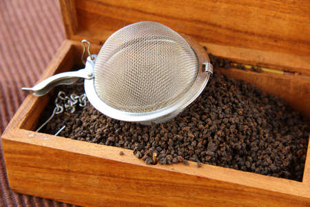 tea strainer with a fragrant black tea