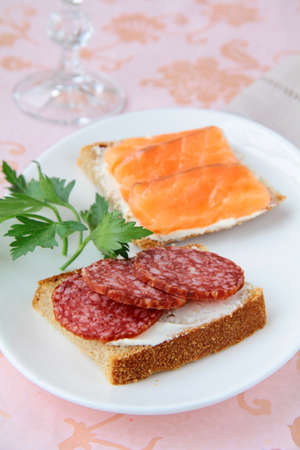 canape sandwiches with salmon  and salami