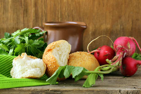 various vegetables and herbs, bread and milk  - rustic still life