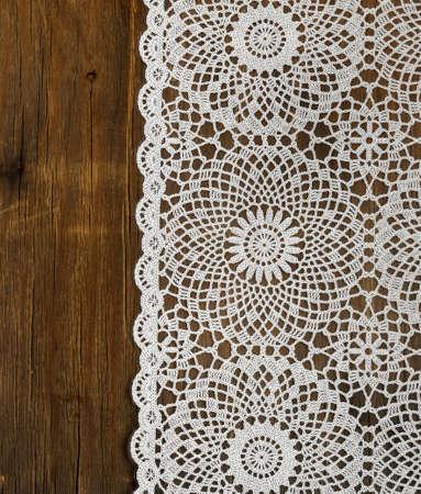 Photo pour wooden background with white lace napkin - image libre de droit