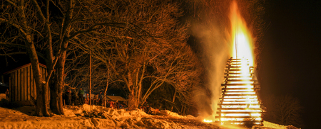 People celebration around big huge traditional fire event.