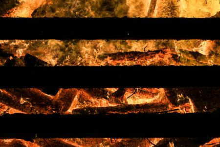 Logs in fire. Big huge traditional fire blaze glow. Background