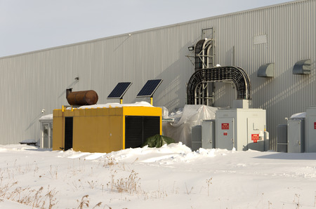 Large industrial standby generator in winter.