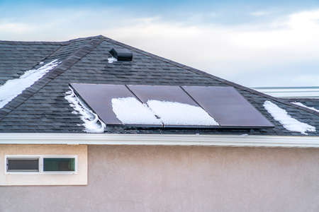 Photo for Solar panels on the roof of a home against blue sky with clouds - Royalty Free Image